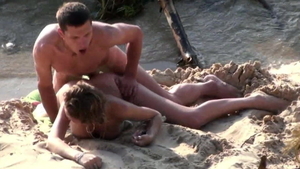 Couple getting smashed very nicely at the beach