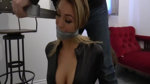Tied up in company with busty british blonde haired