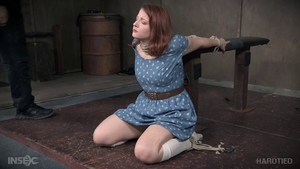 Young redhead gets a buzz out of bondage wearing socks in HD