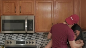 Latina in panties cooking in the kitchen