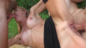Busty chick threesome outdoors