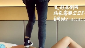 Trampling young chinese in sneakers