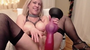 Solo beautiful female playing with toys on webcam
