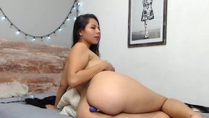 Big ass colombian takes a large dildo